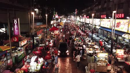 kl : Aerial view in Malaysia, Kuala Lumpur of Jalan Alor with people, restaurants, cars and street markets at night