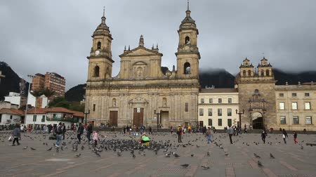 bogota : BOGOTA, COLOMBIA - JUNE 14: Unidentified people walk past the main cathedral in Bolivar Square on June 14, 2016 in Bogota, Colombia. Stock Footage