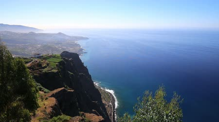 Cliffs with Funchal in the background in Madeira, Portugal.