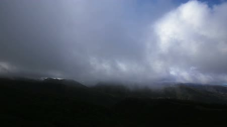 gods : Winter storms darken the foreground in the mountains of Los Padres National Forest in California.