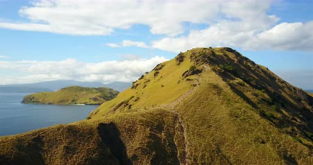 Флорес : Aerial footage rising above Pulau Padar Island Looking South in Komodo, Indonesia.