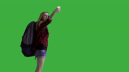 chroma key background : Young attractive female hiker taking a selfie - green screen. Prores 422HQ 4K UHD 60FPS slow motion shot. Shot with Blackmagic URSA Mini Stock Footage