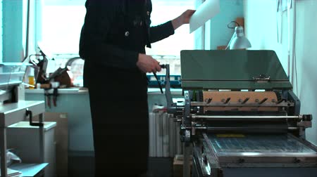 print shop : Making a print on a vintage letterpress machine. Tracking dolly out 4k 60 FPS. Shot with Blackmagic URSA Mini