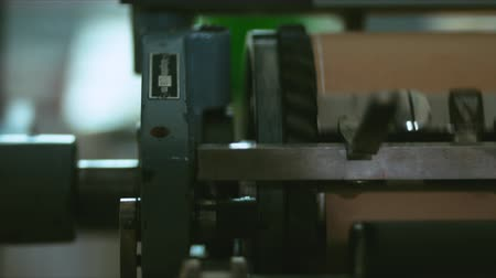 tipo baskı : Making a print on a vintage letterpress machine. Close up 4k 60 FPS. Shot with Blackmagic URSA Mini