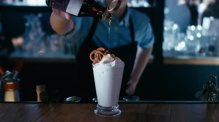 turmix : Barista adding syrup to a milk shake. 4K cinemagraph - motion photo seamless loop