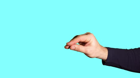 forefinger : Close-up hand gesture - sign of blah blah blah. Male hands showing sign on a blue background.