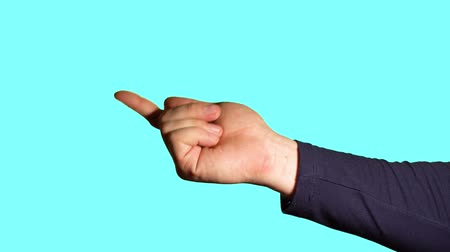 gesture pack : Close-up hand gesture. Male hand shows index finger, calling to itself against a blue background. Stock Footage