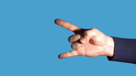 gesture pack : Hand gesture close up - index finger and little finger. Male hand making gesture - index finger and little finger up, the rest of the fingers in a fist on a blue background.
