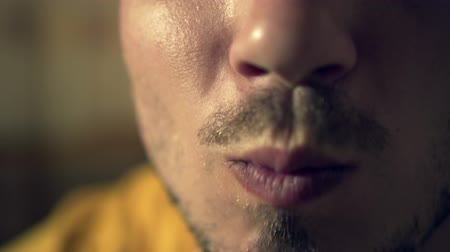 étkező : Profile of a young man, close-up mouth with bristles. Male mouth chews a tasty salad of greens and vegetables.