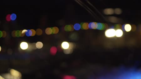 Flashing colored lights. Celebration and party, night city, defocused beautiful bokeh. Circular bokeh colorful.