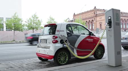 electric : HAMBURG - MAY 30: Electro car is charging in the street on May