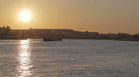 racek : Sunrise in Saint Petersburg with sun reflection on water. Barge slowly moves. Dostupné videozáznamy