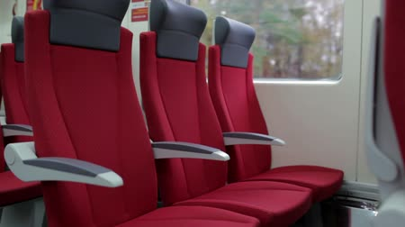trilho : Red chairs in a modern high speed train.