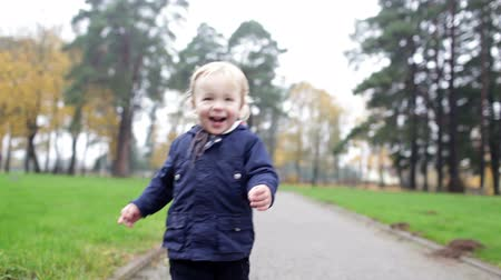 first : A little two year old boy is walking. Slow motion 50frsec