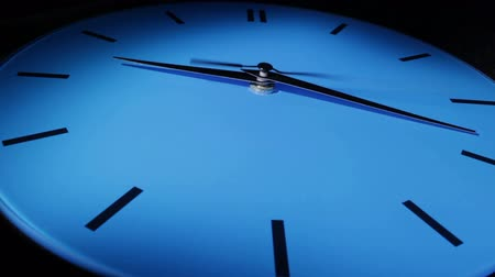clock hands : Blue clock. Time lapse.