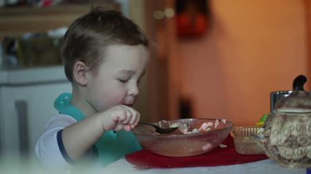oneself : Two year old boy is eating fish soup from the plate. Clip three. Stock Footage