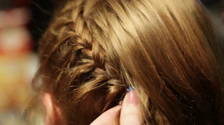 braid hairs : Barber makes the pigtail.