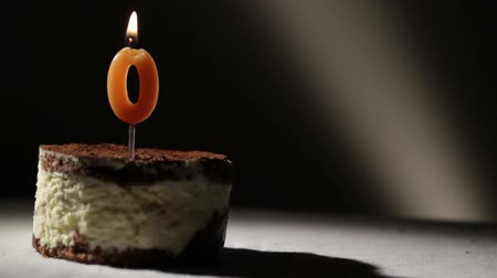 nil : Candle o in tiramisu cake. Birthday vintage background.
