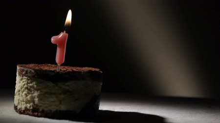 pé : Candle one in tiramisu cake. Birthday vintage background.
