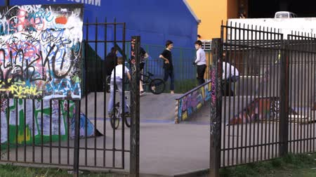 bmx : Performance of teenager cyclists at the backyard Stock Footage