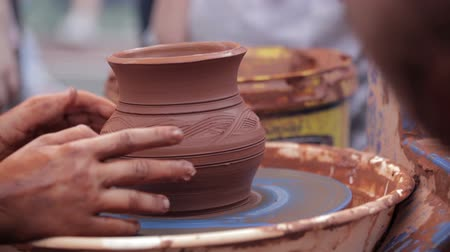 potter wheel : Potter teaches his craft to the child 8 Stock Footage