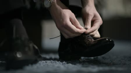 tying : Man tying patent leather shoes. Formal and festive dressing.
