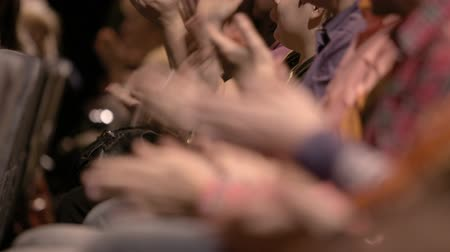 kezek : Close-up of clapping hands of impressed people attending an impressing event. No visible faces. Stock mozgókép