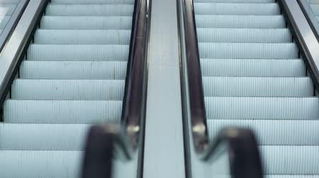close up shot : Close-up shot of empty moving staircase running up and down Stock Footage