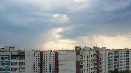blokkok : 4K Timelapse of dark clouds gathering over the multistorey houses in the city