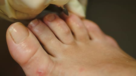 remover : Macro shot of female feet under pedicure at beauty spa salon Vídeos