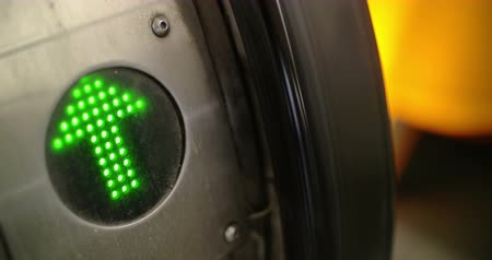 nyilak : Close-up shot of indicator with blinking green arrow on working escalator. Sign allowing to pass