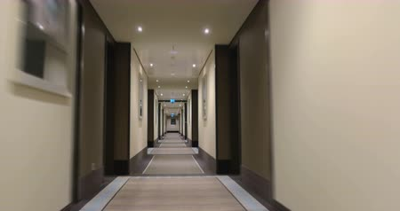 прихожая : Timelapse steadicam shot of moving forward in the hotel corridor. Light and modern design Стоковые видеозаписи