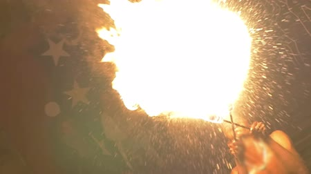 darkskinned : Slow motion shot of an episode of fire show. Dark-skinned fire-breather makes a big explosion of fire. Stock Footage
