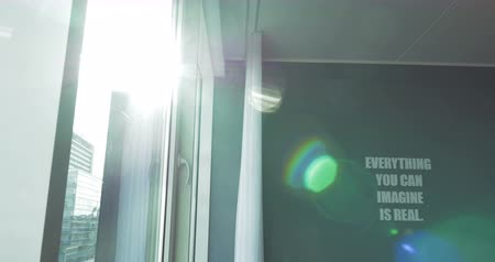 představit si : Shot of a room brightly lit with the Sun. There is a text Everything you can imagine is real on the wall.