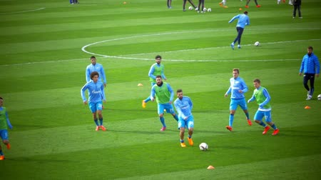 premier : ST. PETERSBURG, RUSSIA - APRIL 5, 2015: Slow motion of football team having a training before the soon match. Coach supervising players. Zenit-CSKA football match, Russian Championship,  Premier League
