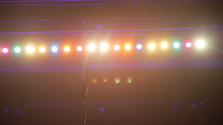 lighting up : Steadicam shot of overhead stage soffites lighting with different colors. Stock Footage