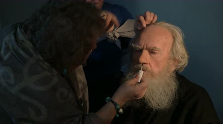 еще : MOSCOW, RUSSIA - FEBRUARY 3, 2015: Make-up artist refreshing makeup of an actor playing a role of Alexey Tolstoy in film Not Yet Evening by Marlen Khutsiev
