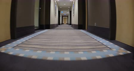 прихожая : Low-angle steadicam shot of moving along the passageway in hotel.