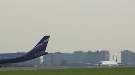 takeoff area : MOSCOW, RUSSIA - JULY 01, 2015: Panning shot of passenger airplane of Russian airlines Aeroflot building up speed and flying-off from Sheremetyevo Airport
