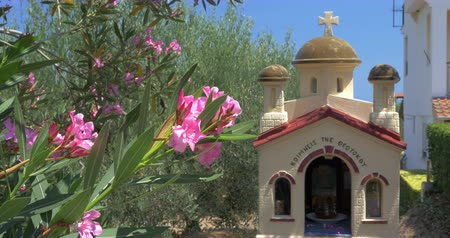 wayside : Greek memorial chapel kandylakia is placed in garden by the road. Stock Footage