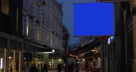 blank : Blank blue screen banner for advertising hanging on the building in night city street Stock Footage