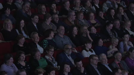 filme : MOSCOW, RUSSIA - MAY 21, 2013: A lot of people in the movie theater watch film and laugh. Russia is visited by more than 20 million turists annually