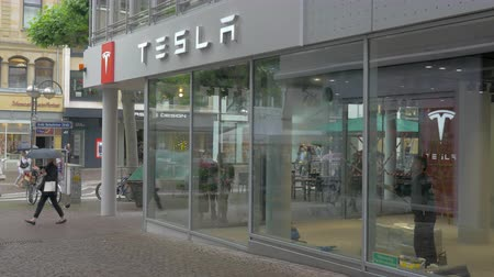 tesla car : FRANKFURT, GERMANY - JULY 01, 2016: City street with Tesla Store and Service Centre. Tesla Motors is an American automaker and energy storage company founded in 2003, it specializes in electric cars