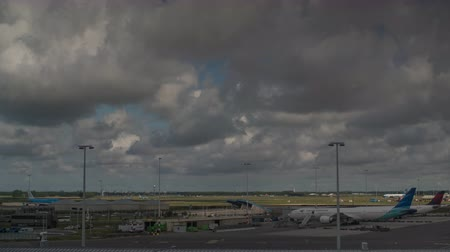takeoff area : AMSTERDAM, NETHERLANDS - AUGUST 04, 2016: Timelapse shot of clouds sailing over Amsterdam Airport Schiphol, the main international airport of the Netherlands,