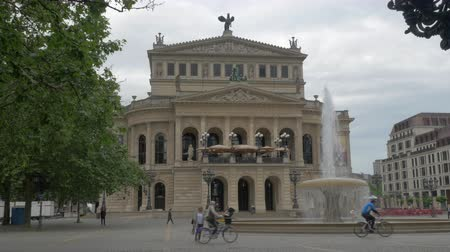 oper : FRANKFURT, GERMANY - JULY 01, 2016: Alter Oper facade and Opernplatz with fountain. Concert hall and former opera house was rebuilt in 1970s after being destroyed in 1944
