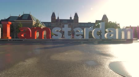 amsterodam : AMSTERDAM, NETHERLANDS - AUGUST 09, 2016: Popular tourist attraction Amsterdam slogan in front of Rijksmuseum in bright sunlight