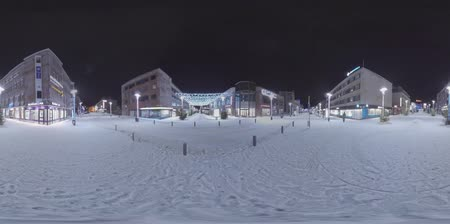 homlokzatok : ROVANIEMI, FINLAND- JANUARY 01, 2017: 360 VR Video. Night city scene. Snowy deserted streets with lit lanterns, Christmas lights and illuminated store fronts