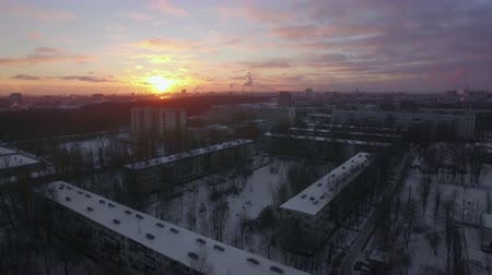 çok katlı : Aerial - Winter St. Petersburg with view to apartments buildings and smoky pipes at skyline. Cityscape at sunrise, Russia Stok Video