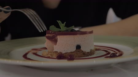yum yum : Close-up shot of a woman enjoying delicious mousse dessert with berries. Having meal in the restaurant Stock Footage