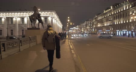 nevsky : Night cityscape of St. Petersburg with car traffic on Nevsky Prospect and people walking along Anichkov Bridge, Russia